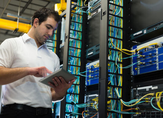 IT technician with network equipment and cables